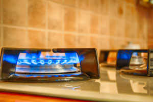 How can I tell if I have a gas leak, and what should I do if I detect one?